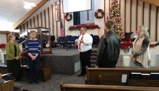 Pastor Mike presenting gifts to the Church Board members
